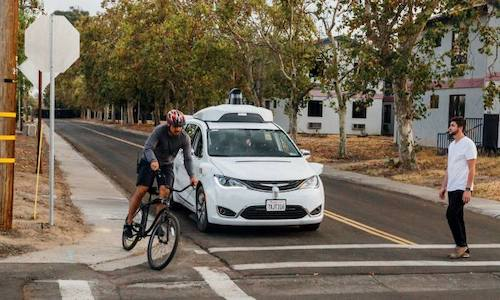 A photo of a Waymo self-driving taxi.